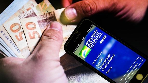 Caixa paga auxílio emergencial a nascidos em fevereiro - economia